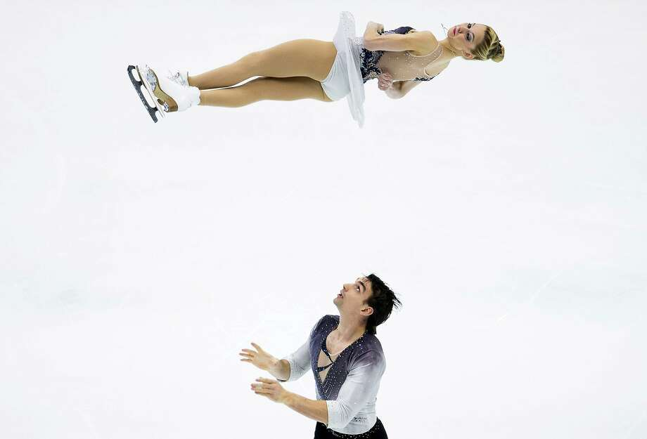 Catch me if you can: American Chris Knierim tosses partner Alexa Scimeca high into the air during the Pairs Short Program event at the Four Continents Figure Skating Championships in Taipei. Photo: Victor Fraile, Getty Images