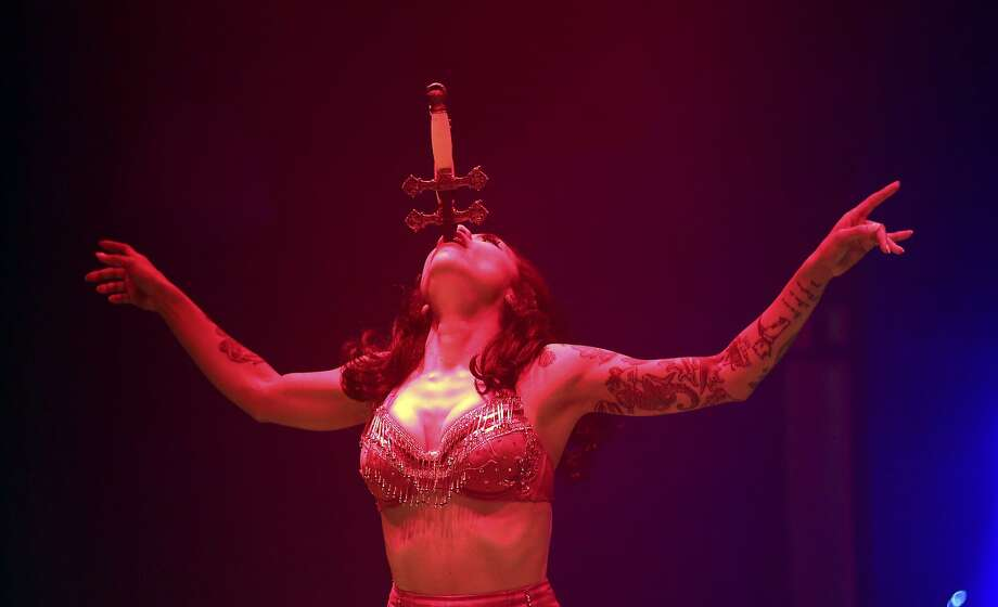More iron in her diet: A performer swallows a sword during the Limbo circus-cabaret show at the Sydney 