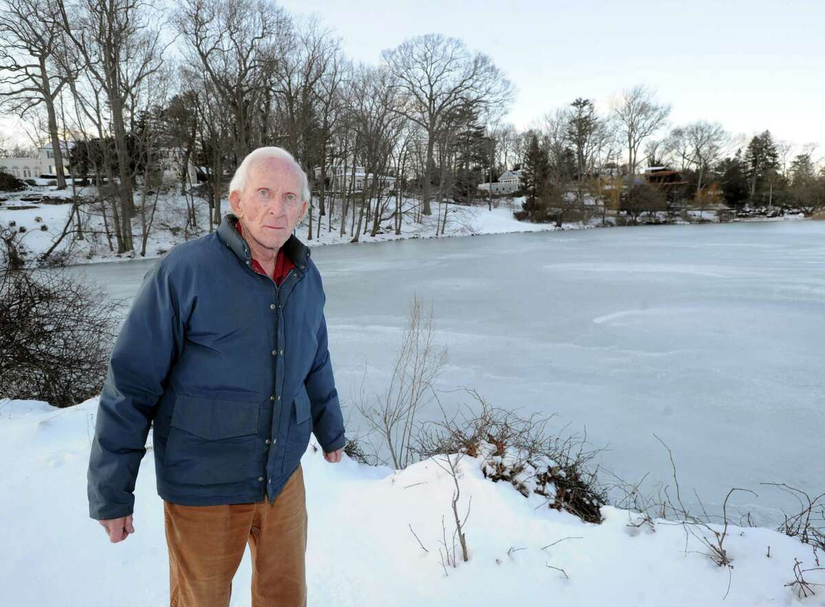 """Paul Palmer stands by the pond in front of his Willowmere Circle home in the Riverside section of Greenwich, Thursday, Jan. 23, 2014. Palmer was instrumental in helping to aid in the rescue of two kids who had fallen through the ice on the pond by calling for emergency help. Palmer said both kids were rescued and are in good condition. Palmer said """"this time of year I keep an eye out on the pond. Seems like every year someone falls through."""""""