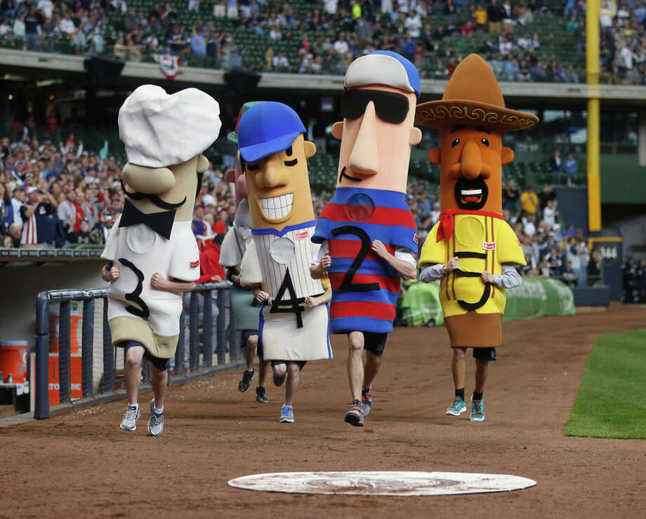 The Brewers's racing sausages aren't the team's official mascots, but we love them regardless. What's not to love about a kielbasa that can run sprints? Photo: Jeffrey Phelps, Getty Images / 2012 Getty Images