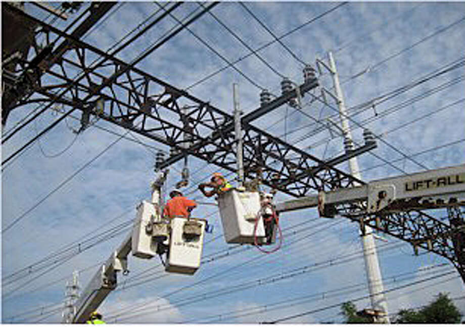 The next phase of overhead wire replacements on Metro-North Railroadís New Haven Line is scheduled to begin early next year. Photo: MTA / Westport News contributed