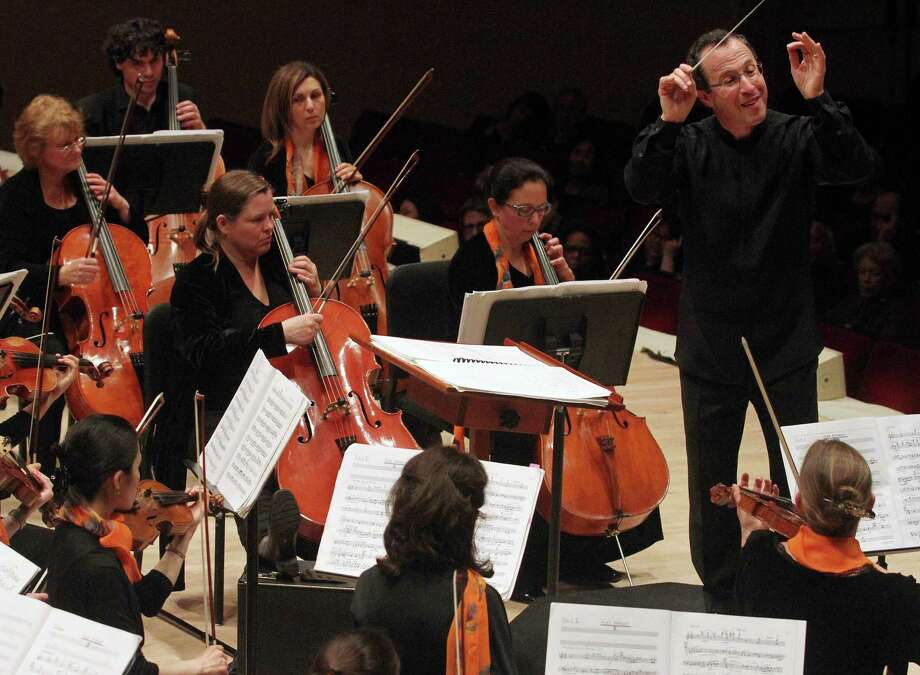 David Alan Miller conducts the Albany Symphony Orchestra during a concert for the Spring For Music series at Carnegie Hall, May 7, 2013. The six-day festival, which runs through Saturday, is  in its third year. (Tina Fineberg/The New York Times) Photo: TINA FINEBERG / NYTNS