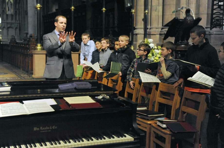 Choir director Woodrow Bynum works with the boys choir at the Cathedral of All Saints on Wednesday Jan. 15, 2014 in Albany, N.Y.  (Michael P. Farrell/Times Union) Photo: Michael P. Farrell / 00025330A