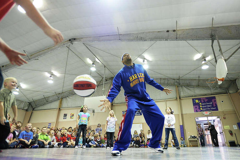Harlem Globetrotters Cheese Chisholm visited Woodcrest Elementary School in Port Neches Thursday and talked to kids about the importance of pursuing a higher education. Michael Rivera/@michaelrivera88