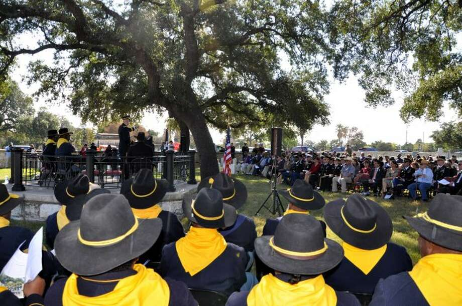 Bexar County Buffalo Soldiers Association, members take part in 2013 Veterans Day celebration honoring their namesakes at San Antonio National Cemetery. Guest speaker is Army Brig. Gen. Kirk F Vollmecke, commander of the Mission and Installation Contracting Command at Fort Sam Houston. Photo: Courtesy Bexar County Buffalo So / San Antonio Express-News