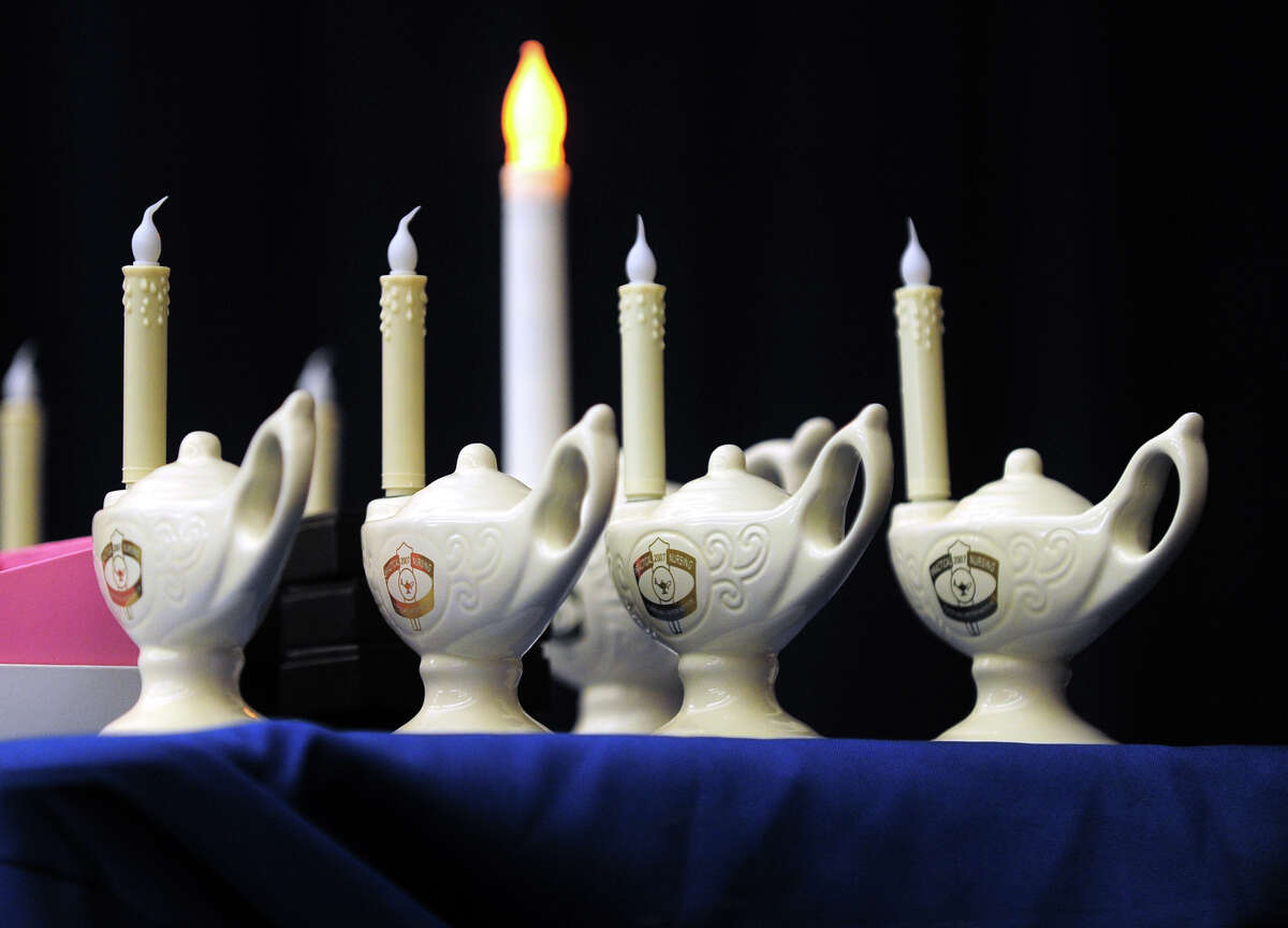 The Stratford campus of Porter and Chester Institute held a Pinning and Candle Lighting Ceremony for its first ever graduating class of nurses at Bunnell High School in Stratford, Conn. on Thursday January 23, 2014.