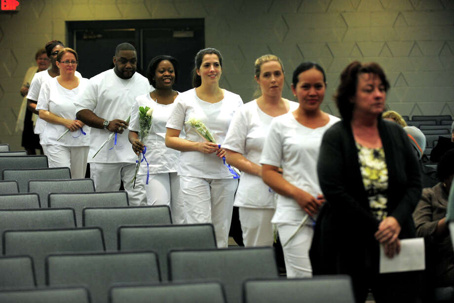 The Stratford campus of Porter and Chester Institute held a Pinning and Candle Lighting Ceremony for its first ever graduating class of nurses at Bunnell High School in Stratford, Conn. on Thursday January 23, 2014. Photo: Christian Abraham / Connecticut Post