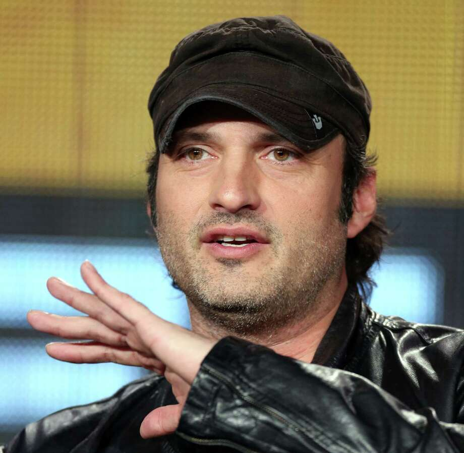 "Filmmaker Robert Rodriguez, who has branched into television with his El Rey Network, is developing a series based on his 1996 cult film ""From Dusk Dawn."" He spoke about the show at the 2014 Winter Television Critics Association Press Tour. Photo: Frederick M. Brown, Stringer / 2014 Getty Images"
