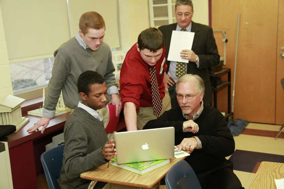 Bill Pomakoy, president of Rhoades Car in Hendersonville, Tenn., spent time with business marketing students from his alma mater, La Salle Institute. Students completed a semester long marketing analysis of Rhoades Car and presented their findings to Pomakoy during his visit.  This project is just one of many within the new Business Marketing curriculum at La Salle Institute. (Submitted photo)