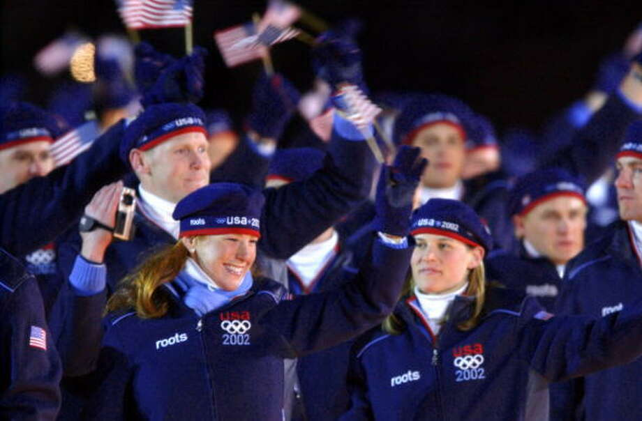 US athletes waves upon their delegation's arrival for the opening ceremonies of the 2002 Winter Olympics at the Rice Eccles Stadium on Feb. 8, 2002 in Salt Lake City, Utah. (JOHN MACDOUGALL/AFP/Getty Images) Photo: JOHN MACDOUGALL, AFP/Getty Images / AFP