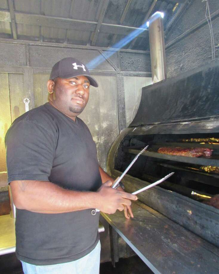 Chris Ashford, youngest son of Edward and Waldean Ashford, the owners of Ed's Smok-N-Q, has taken control as the self-proclaimed CEO of the East Side restaurant on W.W. White Road. Photo: Burt Henry / San Antonio Express-News