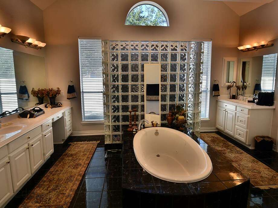15506 Conifer Bay: This 2001 home has 5 bedrooms, 3.5 bathrooms, and 4,972 square feet. Listed for $700,000. Open house: 1/26/2013, 2 p.m. to 4 p.m. Photo: Houston Association Of Realtors