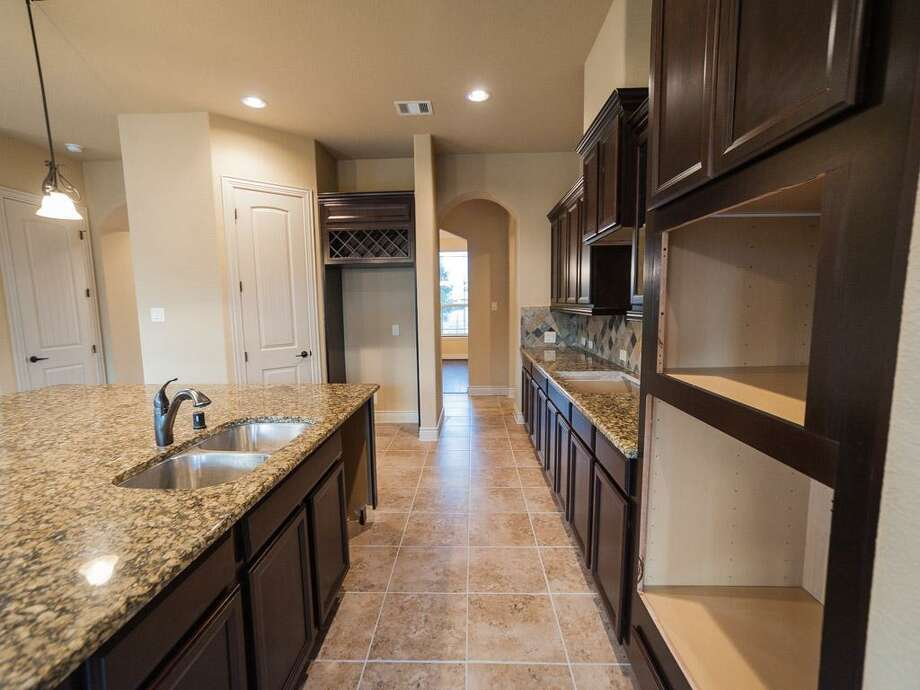 4614 German Bend: This 2013 home has 4 bedrooms, 2.5 bathrooms, and 2,994 square feet. Listed for $323,148. Open house: 1/26/2013, noon to 6 p.m. Photo: Houston Association Of Realtors