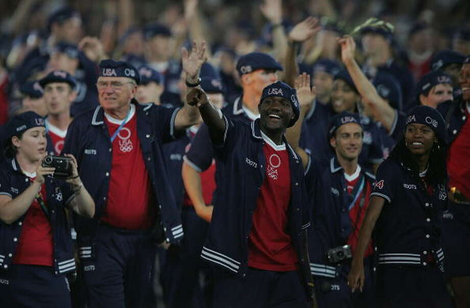 Members of the delegation from the USA wave as they walk during the parade of nations, part of the opening ceremonies for the Athens 2004 Summer Olympic Games on Aug. 13 at the Sports Complex Olympic Stadium in Athens, Greece.  (Photo by Robert Laberge/Getty Images) Photo: Robert Laberge, Getty Images / 2004 Getty Images