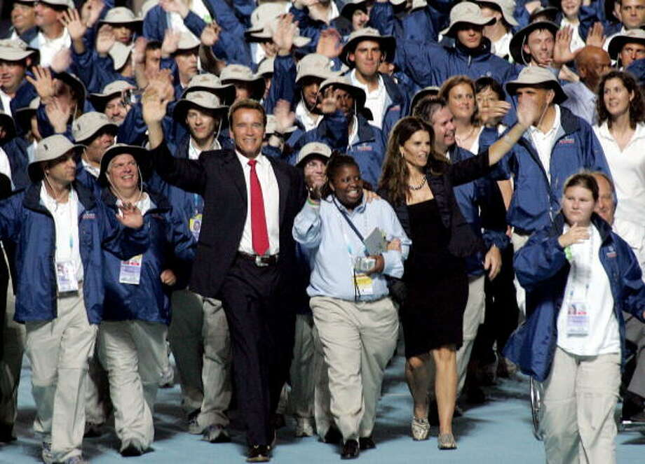 California's Governor Arnold Schwarnegger (3rd L) and his wife Maria Shriver (5th L) join the U.S. athletics as they march on to the stadium during the opening ceremony of the 2007 Special Olympics World Summer Games, in Shanghai  on Oct. 2, 2007.  (GOH CHAI HIN/AFP/Getty Images) Photo: GOH CHAI HIN, AFP/Getty Images / 2007 AFP