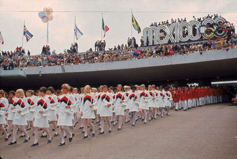 The women of the United States Olympic team lead their male counterparts into the University City Olympic Stadium during the opening ceremonies of the 19th Olympic Games, Mexico City, Oct. 12, 1968. (Robert Riger/Getty Images) Photo: Robert Riger, Getty Images / 2007 Getty Images
