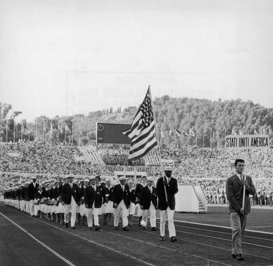 August 1960: The American delegation, wearing suits and hats, marching inside Olympic Stadium during opening ceremonies for the Summer Olympic Games in Rome. Photo: Hulton Archive, Getty Images / Archive Photos