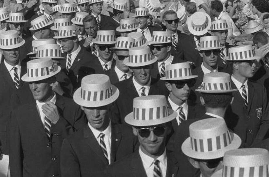 Lookin' cool. The US team en route to the opening ceremony of the 1960 Rome Olympics, wearing straw hats and sunglasses.  Photo: Central Press, Getty Images / Hulton Archive