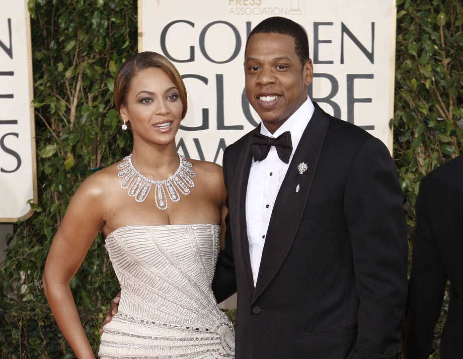 Beyoncé (left) and husband Jay Z will perform at the Gram-mys. Memo to Beyoncé: Next year, release your CD sooner. Photo: Associated Press File Photo / AP2009