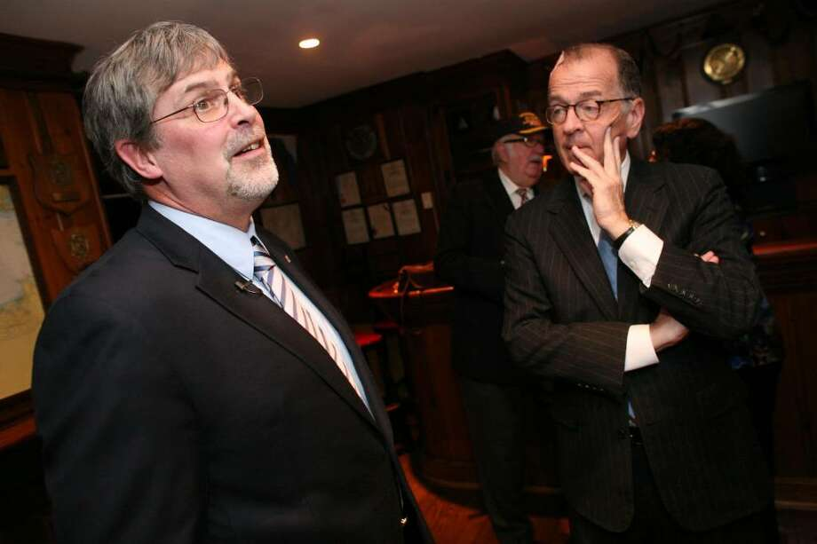 Captain Richard Phillips commanding officer of the American-flagged MV Maersk Alabama talks about his experience being rescued from pirates off the Somali coast as John McCarty listens during a visit the seaman made to the Riverside Yacht Club Wednesday evening. Photo: David Ames, GT / Greenwich Time