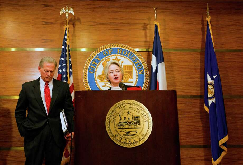 City Attorney David Feldman, left, looks on as Mayor Annise Parker announces that the City of Houston has filed a lawsuit against the Firefighter's Pension Fund seeking to force negotiations, Wednesday, Jan. 22, 2014, in Houston. (Cody Duty / Houston Chronicle) Photo: Cody Duty, Staff / © 2014 Houston Chronicle