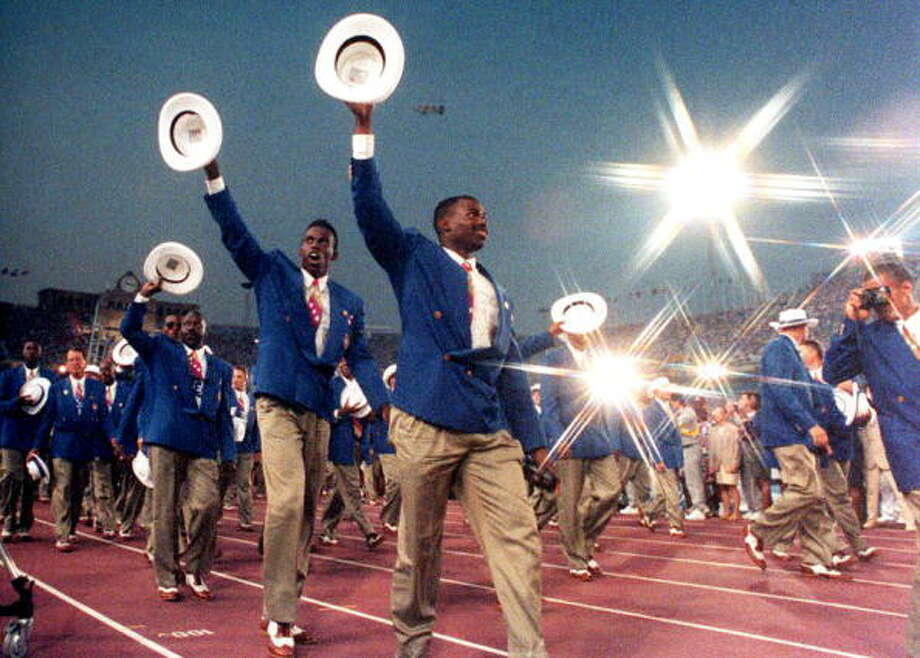 Members of the U.S. Olympic delegation wave to the crowd as they enter the Olympic Stadium to attend the opening ceremonies for the 1992 Barcelona Olympic Games.(RONALD KUNTZ/AFP/Getty Images) Photo: RON KUNTZ, AFP/Getty Images / AFP