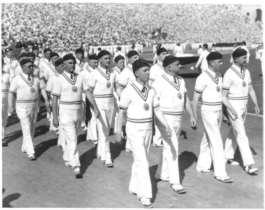 The U.S. Olympic team marches in berets during the Opening Ceremony of the 1932 Summer Olympics at the Los Angeles Memorial Coliseum on July 30, 1932 in Los Angeles, Calif. (B Bennett/Getty Images) Photo: B Bennett, Getty Images / 1932 B Bennett