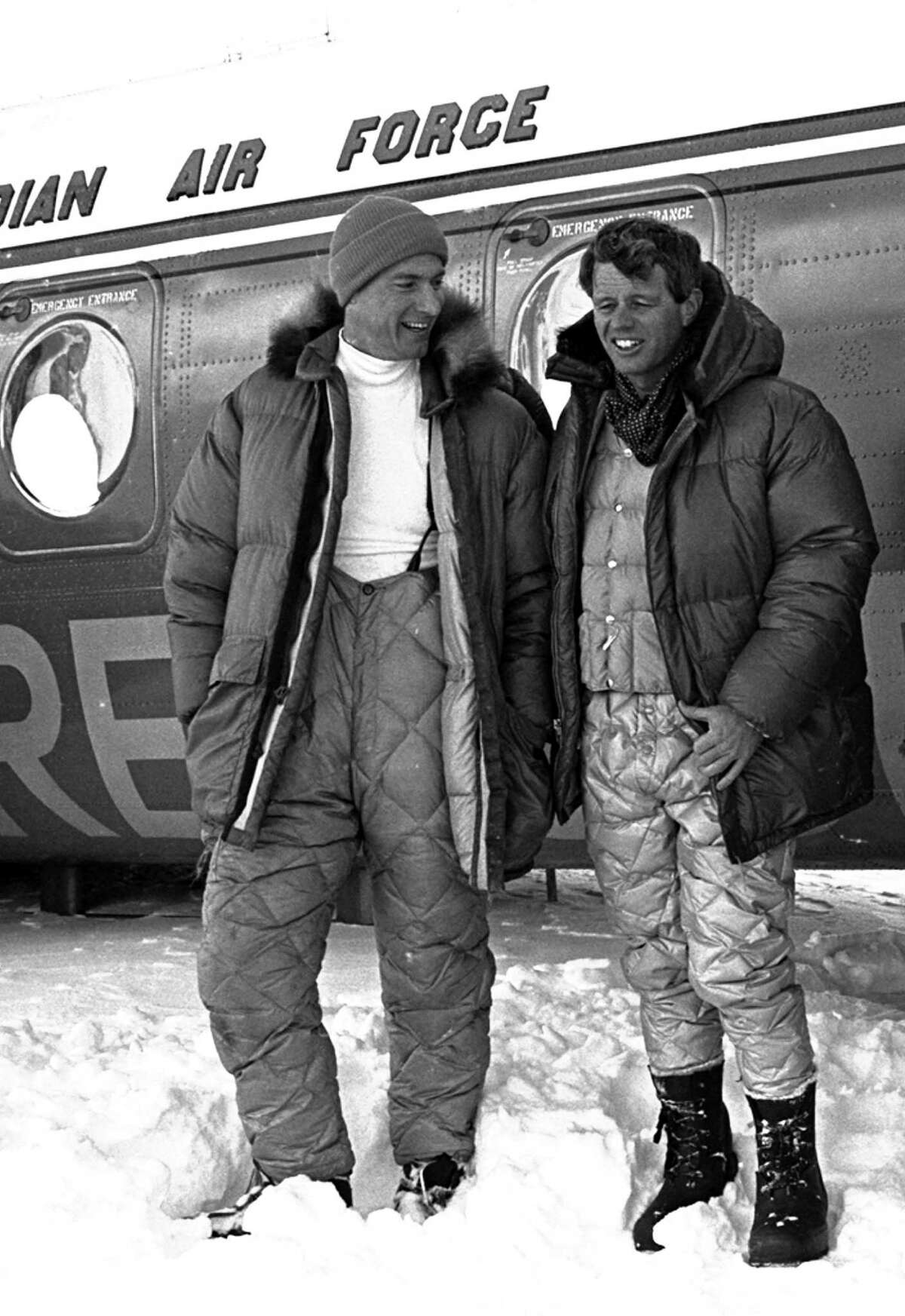 Jim Whittaker, wearing knit cap, and Senator Robert F. Kennedy, are shown arriving at the base camp of Mt. Kennedy, 150 miles west of Whitehorse, Yukon Territory, Canada, March 24, 1965. Artist/mapmaker/author Dee Molenaar was another member of the first ascent of 13,944-foot peak. (AP Photo/Doug Wilson)