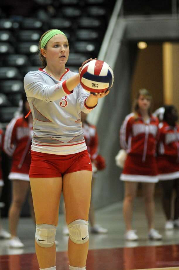 Bellville senior Briana Klotz sets to serve against College Station in the semifinals of the 2013 UIL Volleyball State Tournament at the Culver Center in Garland on Friday. Photo: For The Chronicle