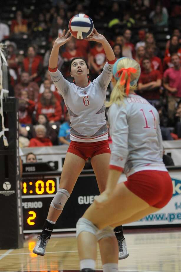 Bellville senior setter Hannah Baker works for one of her match-high 36 assists against College Station in the semifinals of the 2013 UIL Volleyball State Tournament at the Culver Center in Garland on Friday. Photo: For The Chronicle