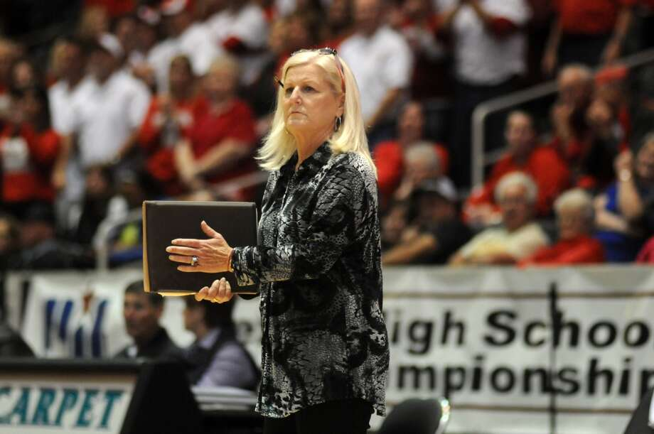 Bellville Head Coach Susan Brewer calls a serve against College Station in the semifinals of the 2013 UIL Volleyball State Tournament at the Culver Center in Garland on Friday. Photo: For The Chronicle