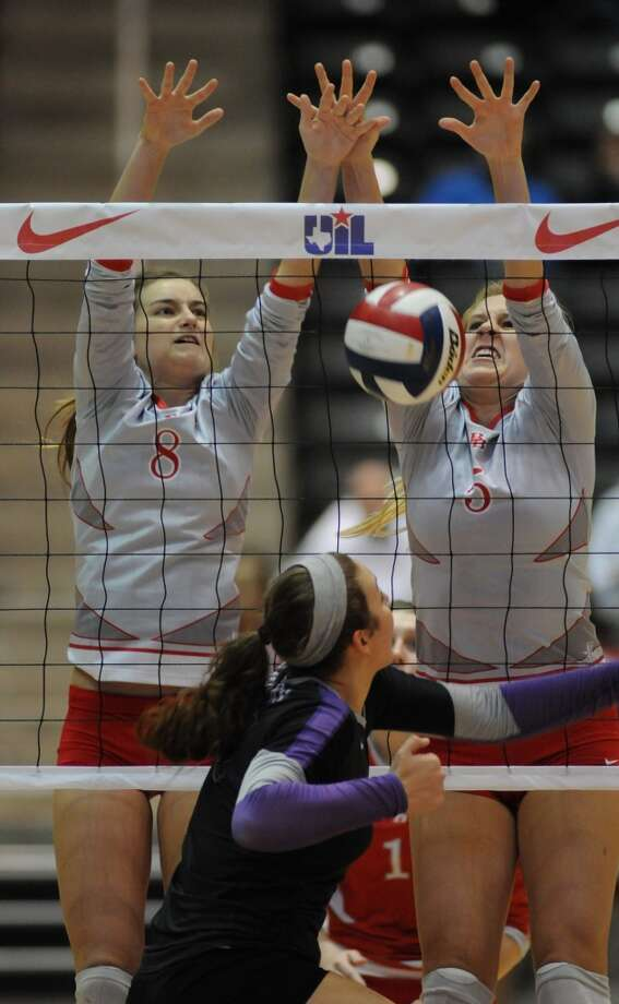 Bellville sophomore Jenna Lewellen, from left, and Lorin Robertson team up for a block against College Station during the Brahmanette's 4 set win over the Lady Cougars in the class 3A semifinals of the 2013 UIL Volleyball State Tournament at the Culver Center in Garland on Friday. Photo: For The Chronicle