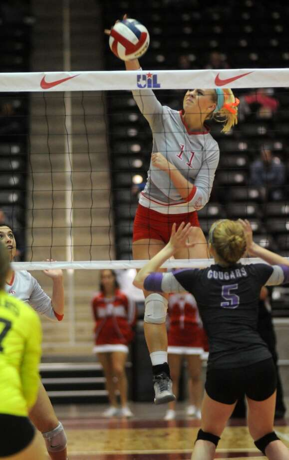Bellville sophomore Reilly Kuestler, right, sends a kill past two College Station defenders during the Brahmanette's 4 set win over the Lady Cougars in the class 3A semifinals of the 2013 UIL Volleyball State Tournament at the Culver Center in Garland on Friday. Photo: For The Chronicle