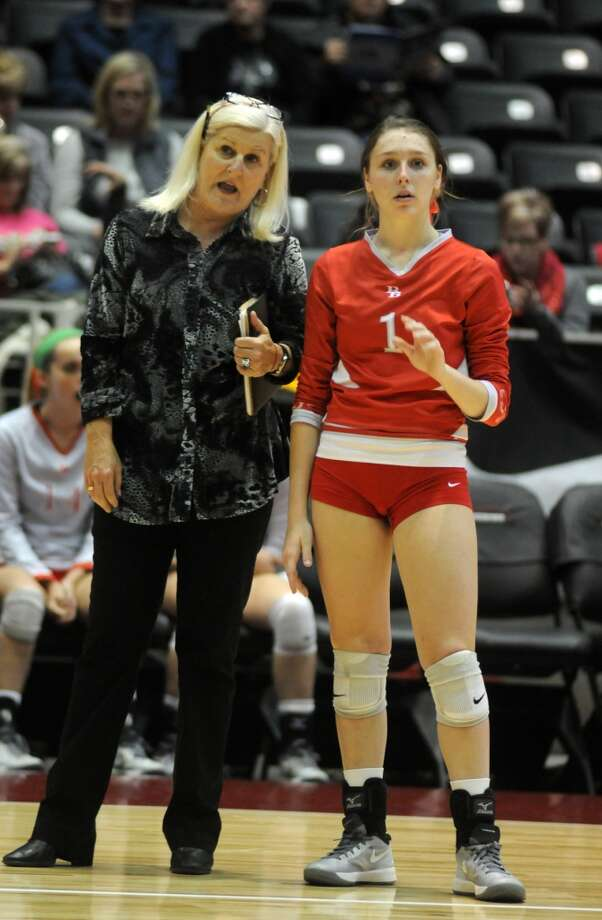 Bellville Head Coach Susan Brewer, from left, goes one-on-one with junior Libero Keeton Holcomb during the Brahmanette's 4 set win over the College Station Lady Cougars in their class 3A semifinals of the 2013 UIL Volleyball State Tournament at the Culver Center in Garland on Friday. Photo: For The Chronicle