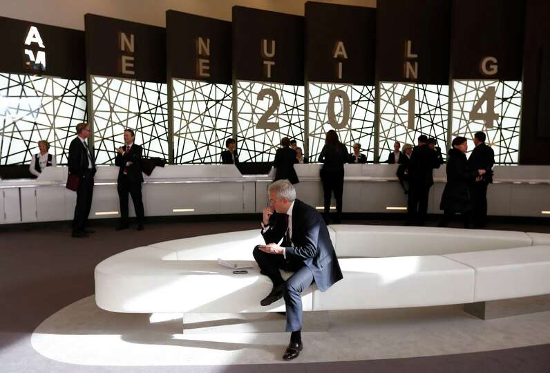 Delegates take a break from sessions on day two of the World Economic Forum (WEF) in Davos, Switzerl