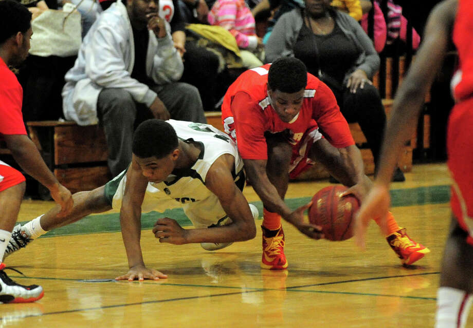 Central's Tyler Ancrum, right, steals the ball away from Bassick's Rajohn James, during boys basketball action in Bridgeport Conn. on Thursday January 23, 2014. Photo: Christian Abraham / Connecticut Post