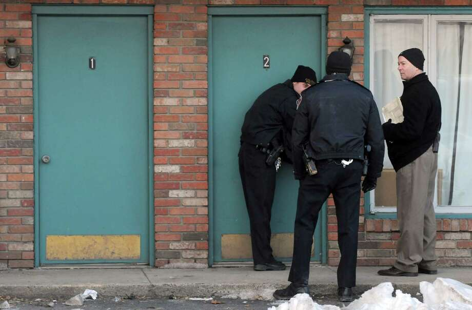 Colonie Police begin the process of eviction at the Skylane Motel on Thursday Jan. 23, 2014 in Colonie, N.Y. (Michael P. Farrell/Times Union) Photo: Michael P. Farrell / 00025467A