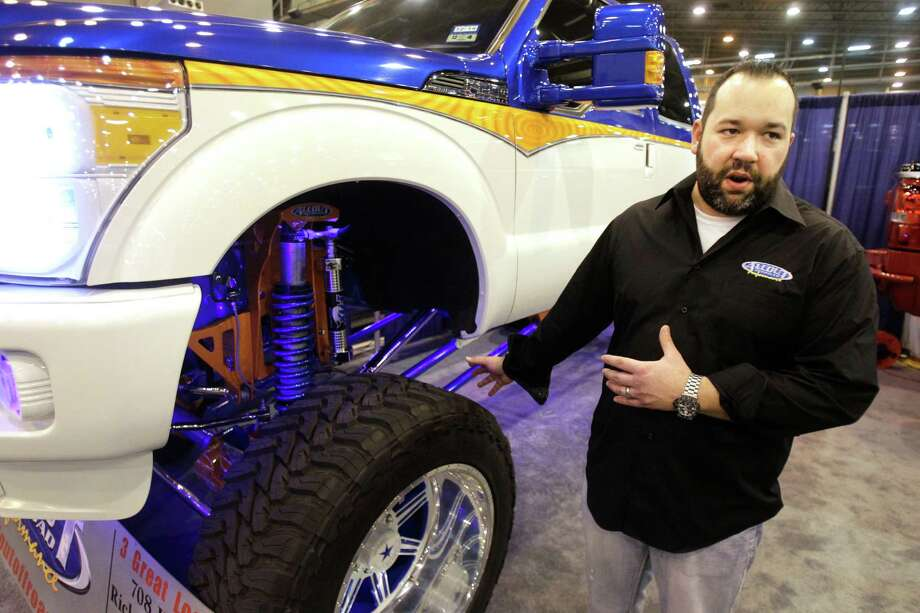 Mike Clark, manger of Allout Offroad Performance, talks about the highly customized truck shown at their display at the Houston Auto Show in Reliant Center Thursday, Jan. 23, 2014, in Houston. Photo: Melissa Phillip, Houston Chronicle / © 2014  Houston Chronicle