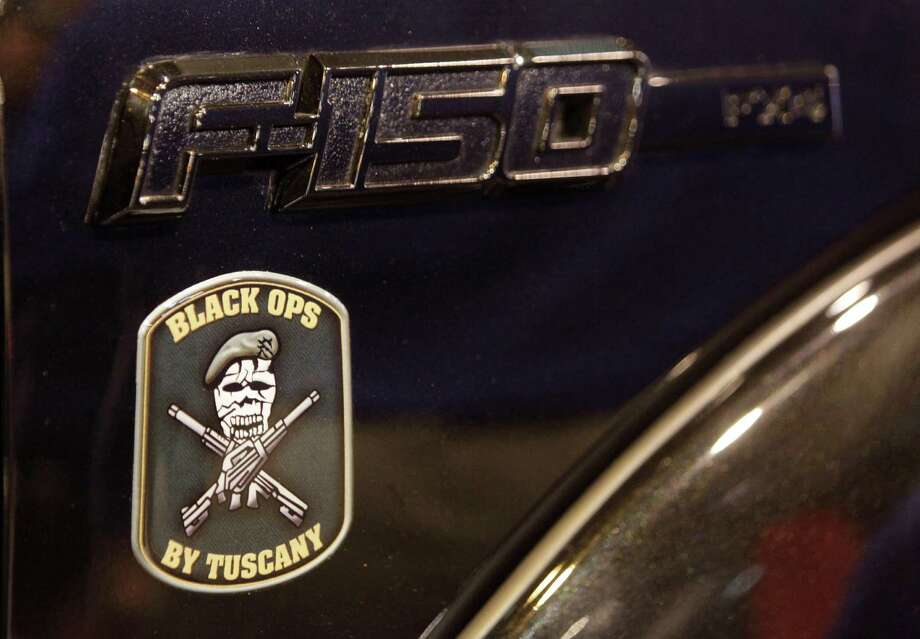 Emblem shown on a custom Tuscany Ford F-150 Black Ops edition truck at the Houston Auto Show. Photo: Melissa Phillip, Houston Chronicle / © 2014  Houston Chronicle