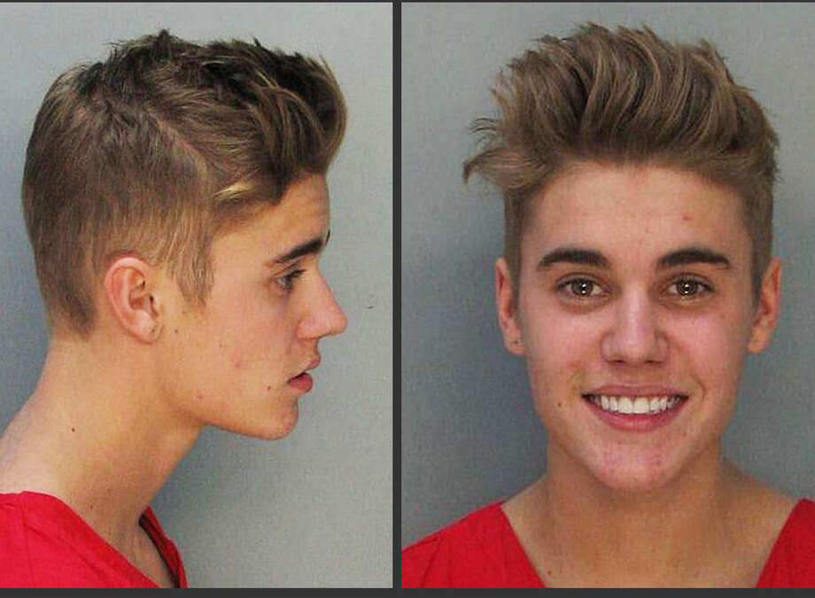 Justin Bieber smiled for the authorities taking his mug shot after his DUI arrest in January 2014. Photo: Miami-Dade County Jail / Miami Dade County Jail