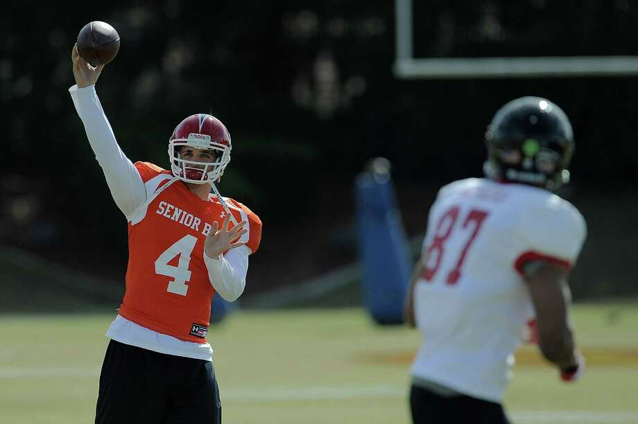 Derek Carr was impressive throwing the ball for NFL personnel this week at the Senior Bowl practices in Mobile, Ala. He's currently projected as a mid-first-round to mid-second-round selection. Photo: Stacy Revere, Contributor / 2014 Stacy Revere