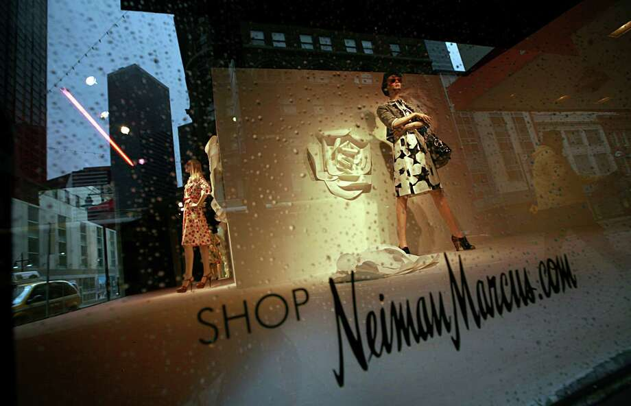 FILE - In this March 11, 2009, file photo, pedestrians pass by the windows of the Neiman Marcus store in Dallas. Neiman Marcus Group Ltd. said Thursday, Jan. 16, 2014, that customers' Social Security numbers and birthdates to its knowledge were not stolen in a security breach that happened over the holiday season. (AP Photo/Tom Pennington, File) Photo: Tom Pennington, FRE / FR23722 AP