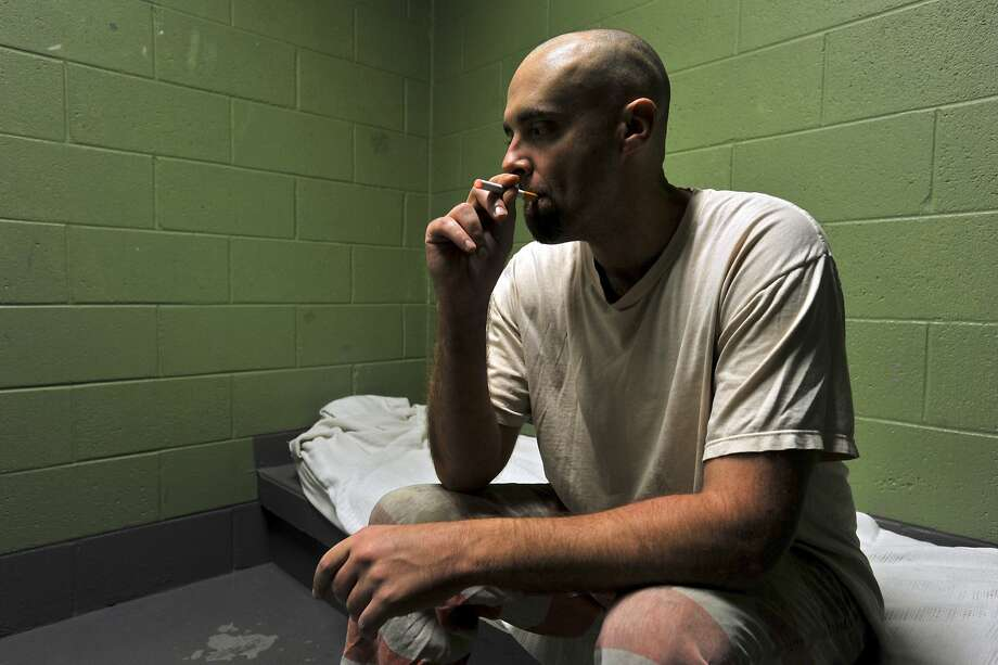 Macon County Jail inmate Logan Smith smokes an electronic cigarette in Lafayette, Tenn. Photo: Christopher Berkey, New York Times