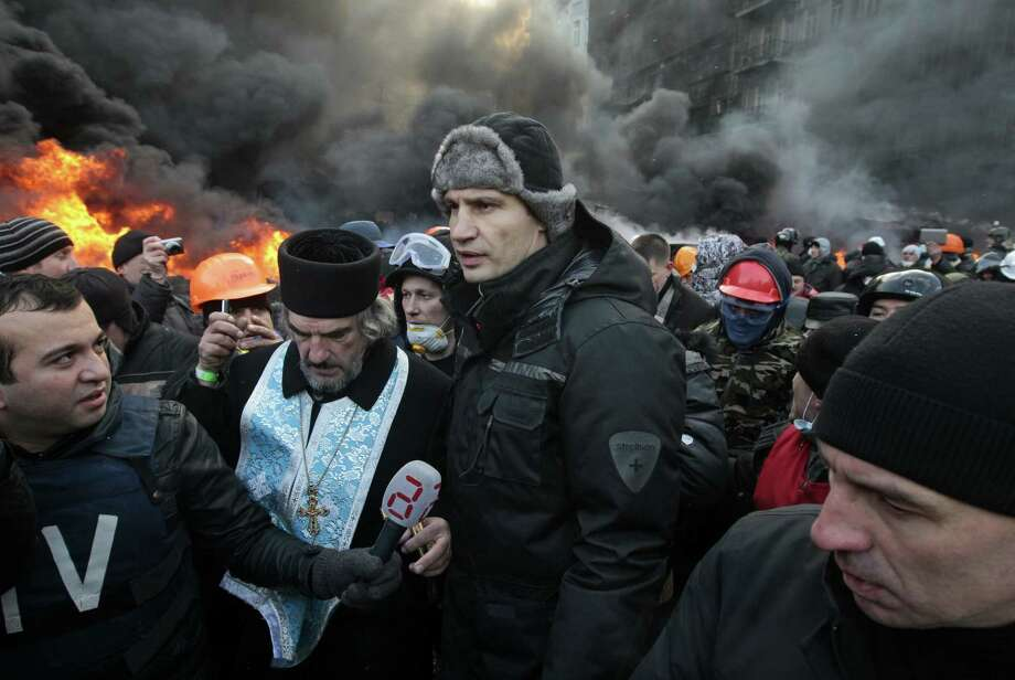 UDAR opposition party leader Vitali Klitschko (center), a former WBC heavyweight champion addressing a gathering in downtown Kiev, says negotiations would resume but didn't say when. Photo: Sergei Chuzavkov / Associated Press / AP