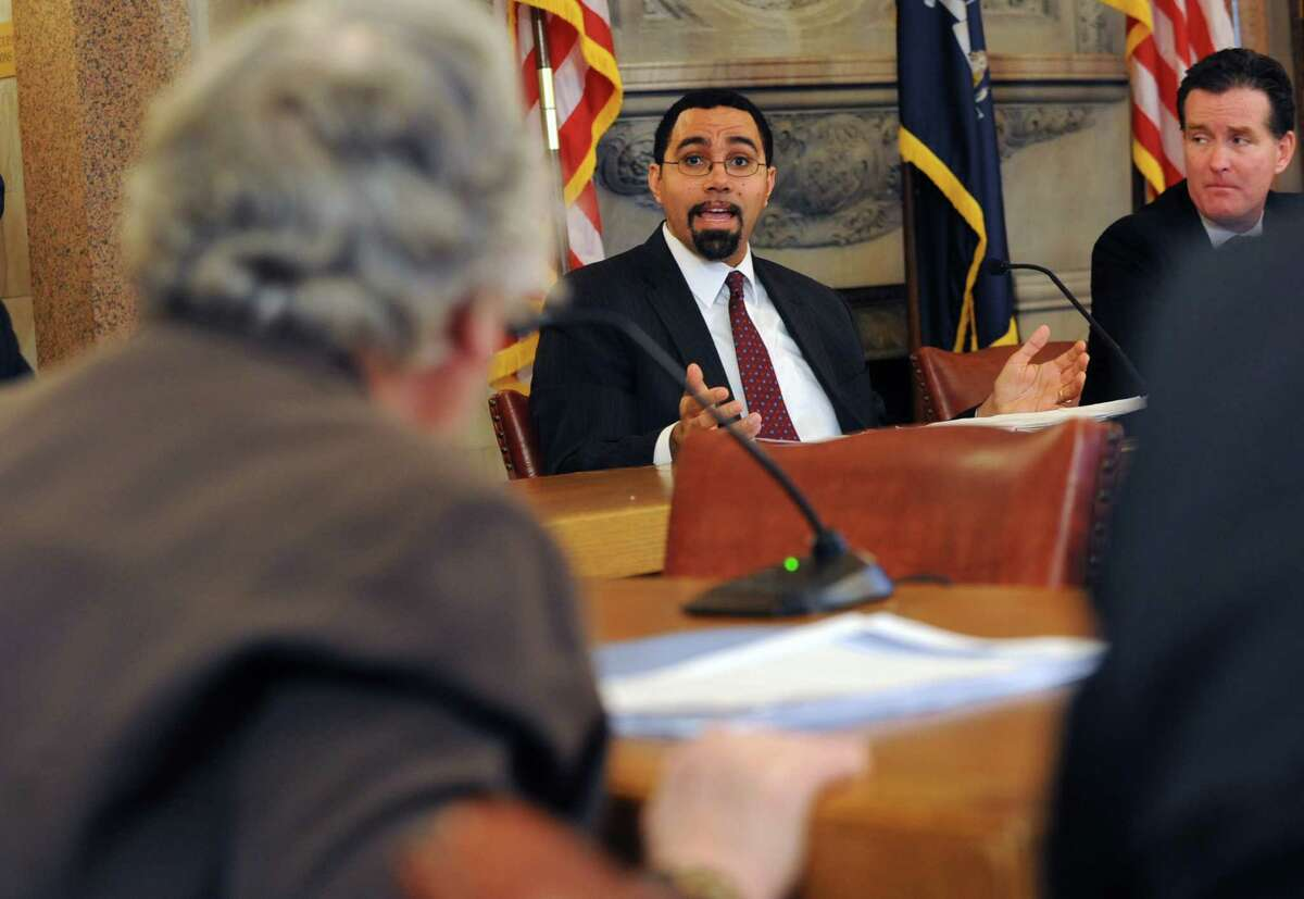 NYS Education Commissioner John King, center, answers a question from Senator Toby Ann Stavisky, left, as he holds a meeting with his committee at the Capitol on Thursday, Jan. 23, 2014 in Albany, N.Y. (Lori Van Buren / Times Union)