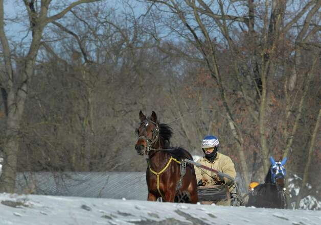 Harness racing trainers take their charges out for some work in the relatively warm part of the day Thursday afternoon Jan. 23. 2014 at the Saratoga Raceway in Saratoga Springs, N.Y.    (Skip Dickstein / Times Union) Photo: SKIP DICKSTEIN