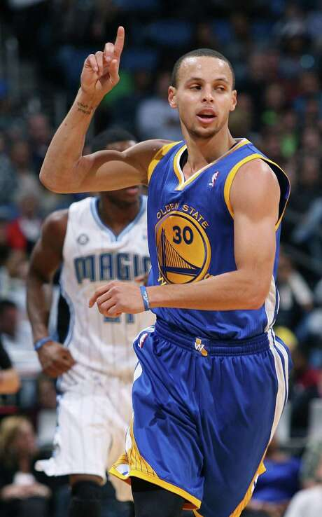Stephen Curry becomes the Warriors' first All-Star starter in 19 years after being left out of last year's game. Photo: Stephen M. Dowell, MBR / Orlando Sentinel