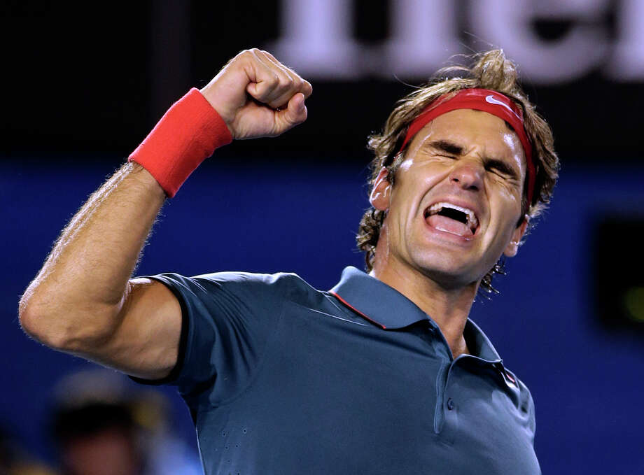 Roger Federer of Switzerland celebrates after defeating Andy Murray of Britain during their quarterfinal at the Australian Open tennis championship in Melbourne, Australia, Wednesday, Jan. 22, 2014.(AP Photo/Rick Rycroft) ORG XMIT: XMEL423 Photo: Rick Rycroft / AP