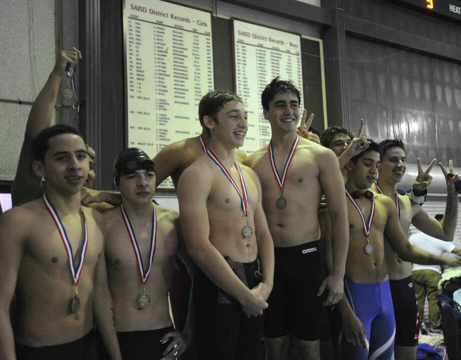 Members of Fox Tech's winning 200-yard relay team receive their medals Thursday at San Antonio Natatorium. Fox Tech finished third in the District 30-4A boys standings. Photo: Photos By Billy Calzada / San Antonio Express-News / San Antonio Express-News