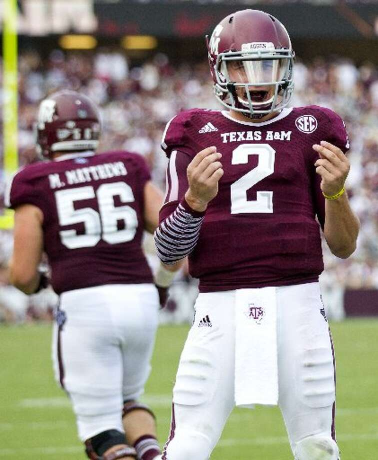 In 2013, Manziel was under investigation by the NCAA for allegedly signing autographs for profit. After an off-season of headline-grabbing antics, he was suspended for half a game in the Aggies' season opener against Rice. Photo: Brett Coomer, Houston Chronicle